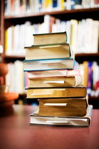 stack of books in a library